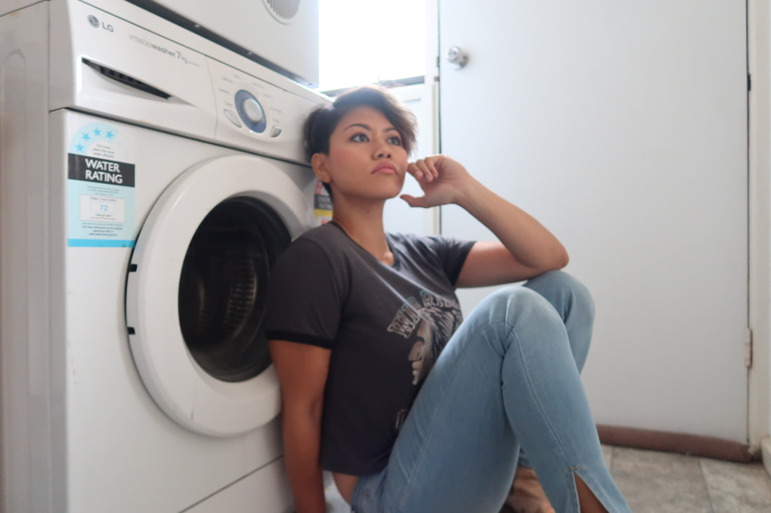 Najah Onn ponders by the laundry Fashion Revolution Week 2019